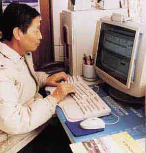 Figure 2 Korean Farmer Using a Computer and Modem to Search the Internet for Technical Information